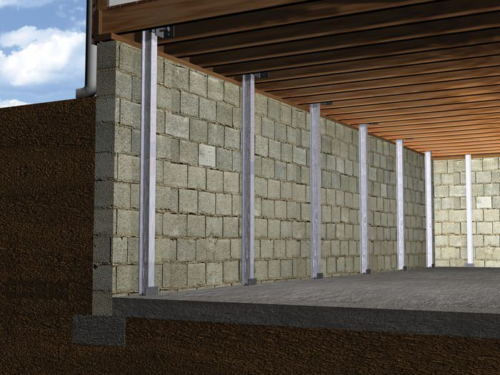 beam foundation wall supports installed in a osage basement